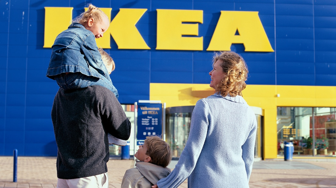 a family walking up to the entrance of an ikea store 6dea7ae2e2f25bc56321429b11efb144